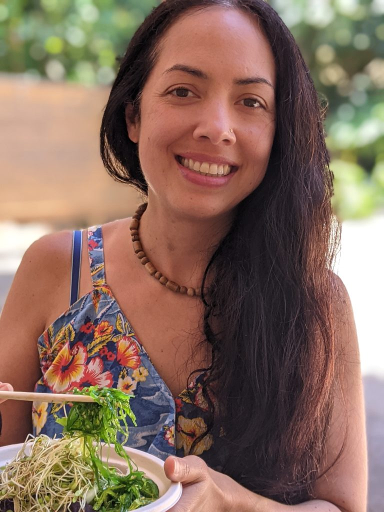 Chef Veggie Cristina Carolan at Kauai Poke Co eating a sweet potato poke bowl Vegan Kauai Eats